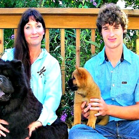 Connie and her son with dogs