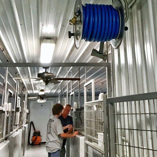 Inspecting High-Tech Indoor Kennels