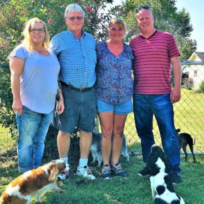 Puppies 'N Love & Animal Kingdom owner Frank Mineo Jr. and Animal Health Director Michelle L. wiith Stacy and her husband on 2016 breeder trip