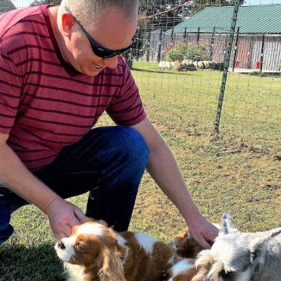 Frank Mineo Jr. playing with Stacy\'s dogs on 2016 breeder trip