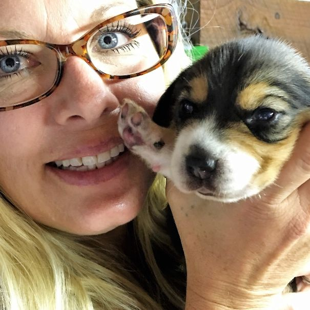 Animal Health Director Michelle L. holding puppy