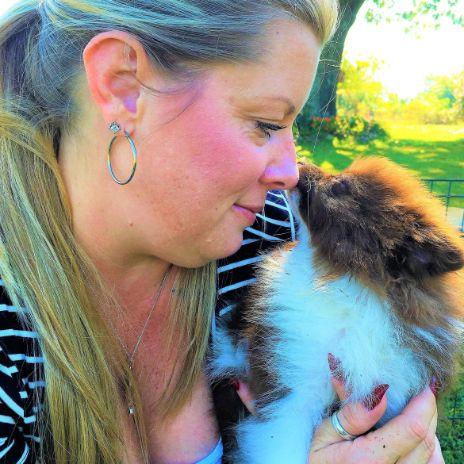 Puppies 'N Love & Animal Kingdom Animal Health Director Michelle L. holding Pomeranian dog