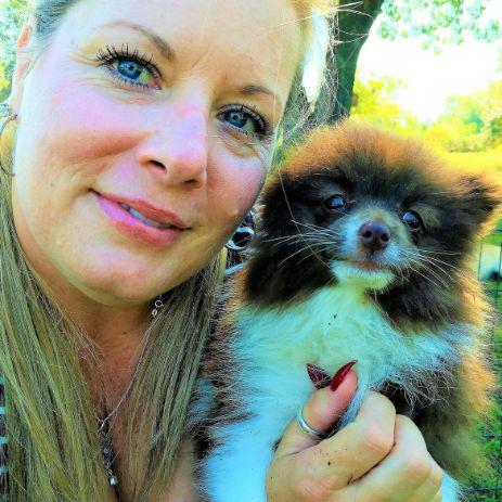 Michelle L. cuddles Pomeranian