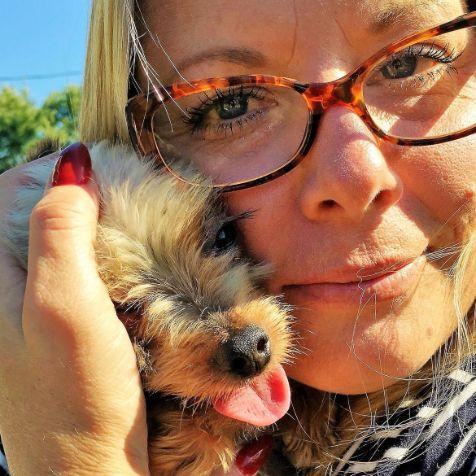 Michelle L. cuddles Yorkshire Terrier