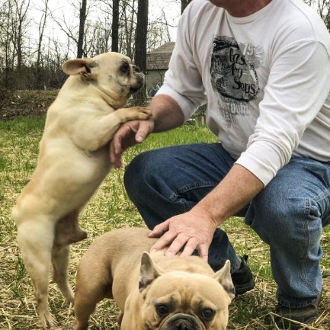 Jim with two of his French Bulldogs