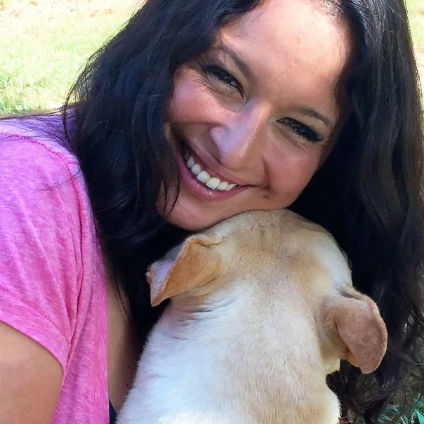 Puppies 'N Love store manager Loni T. snuggles with one of Jim and Tammy\'s dogs