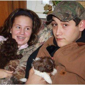 Arminta's children holding Shih Tzu puppies