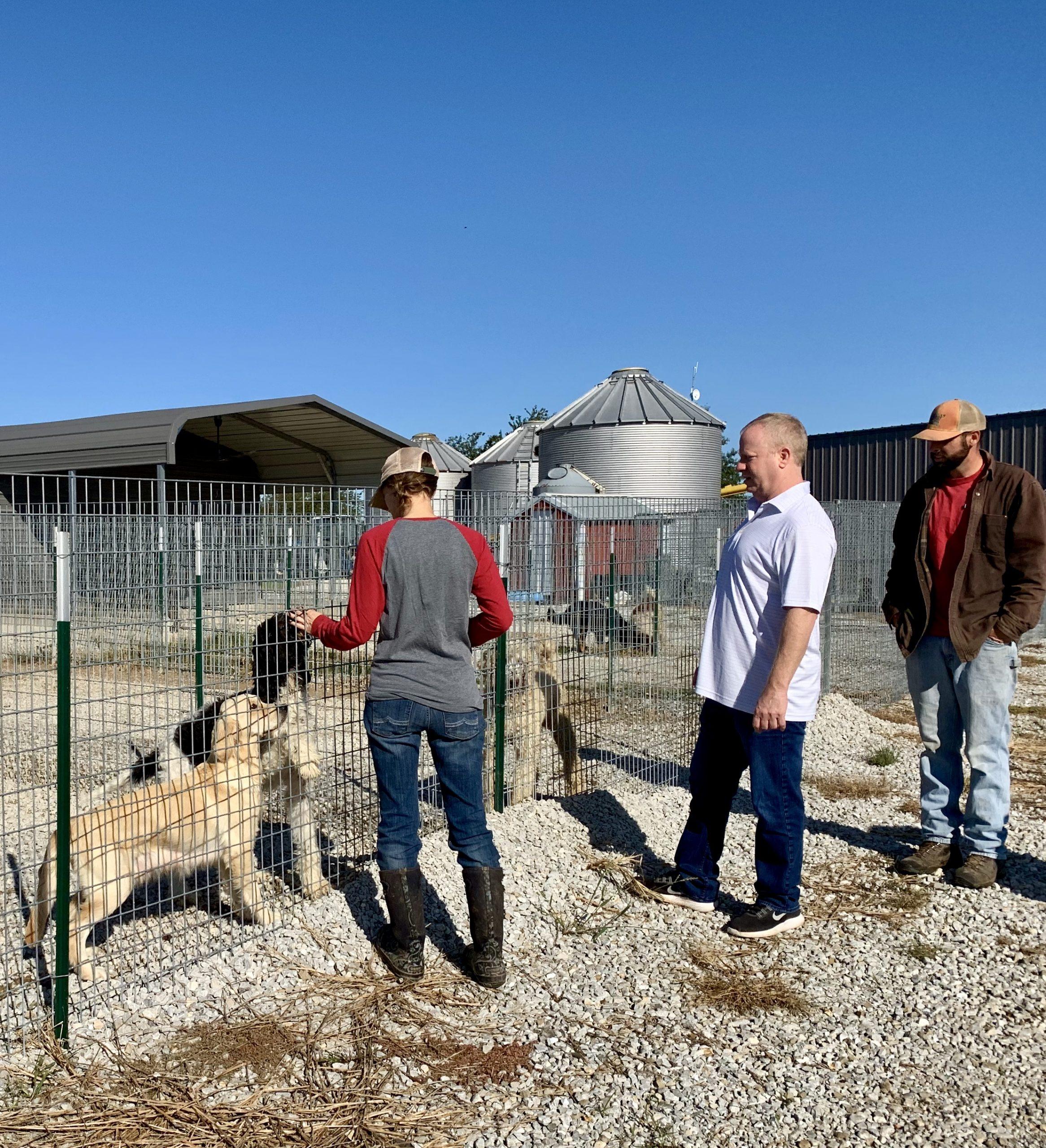 Frank Mineo Jr inspecting Megan's kennel