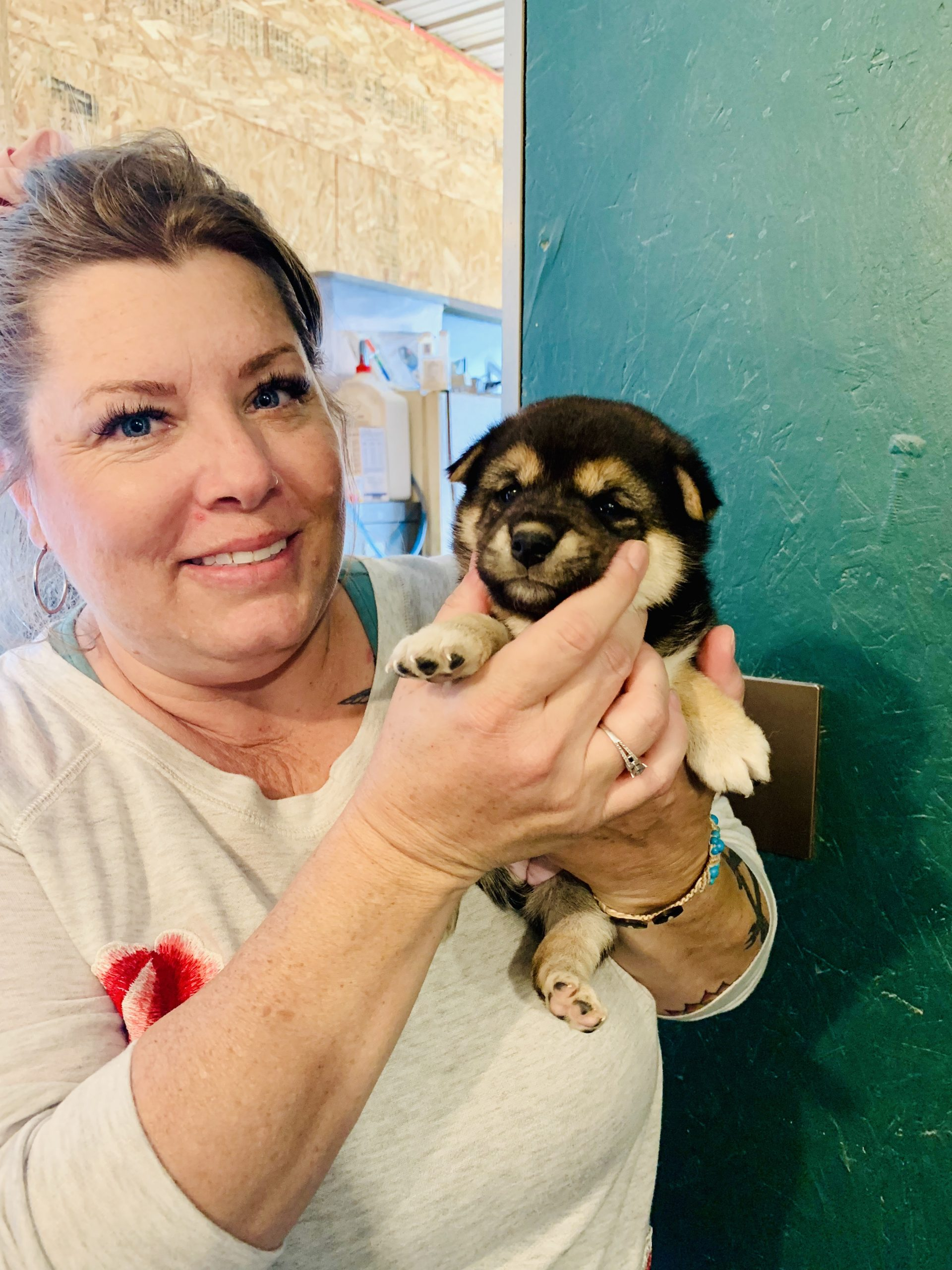 CPI employee holding one of Tim and Lisa's puppies