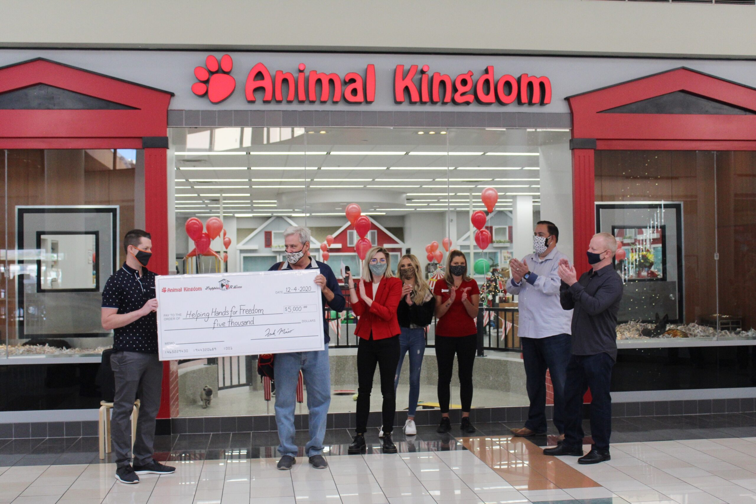 Eric accepting donation from Animal Kingdom