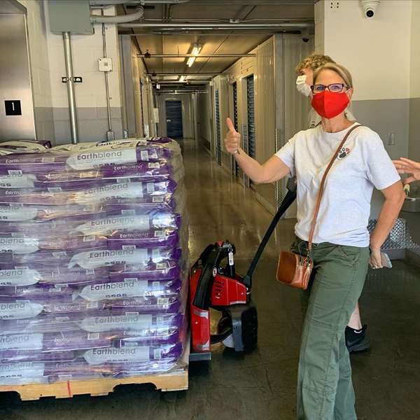 Lisa with the pallet of Earthblend Dog Food