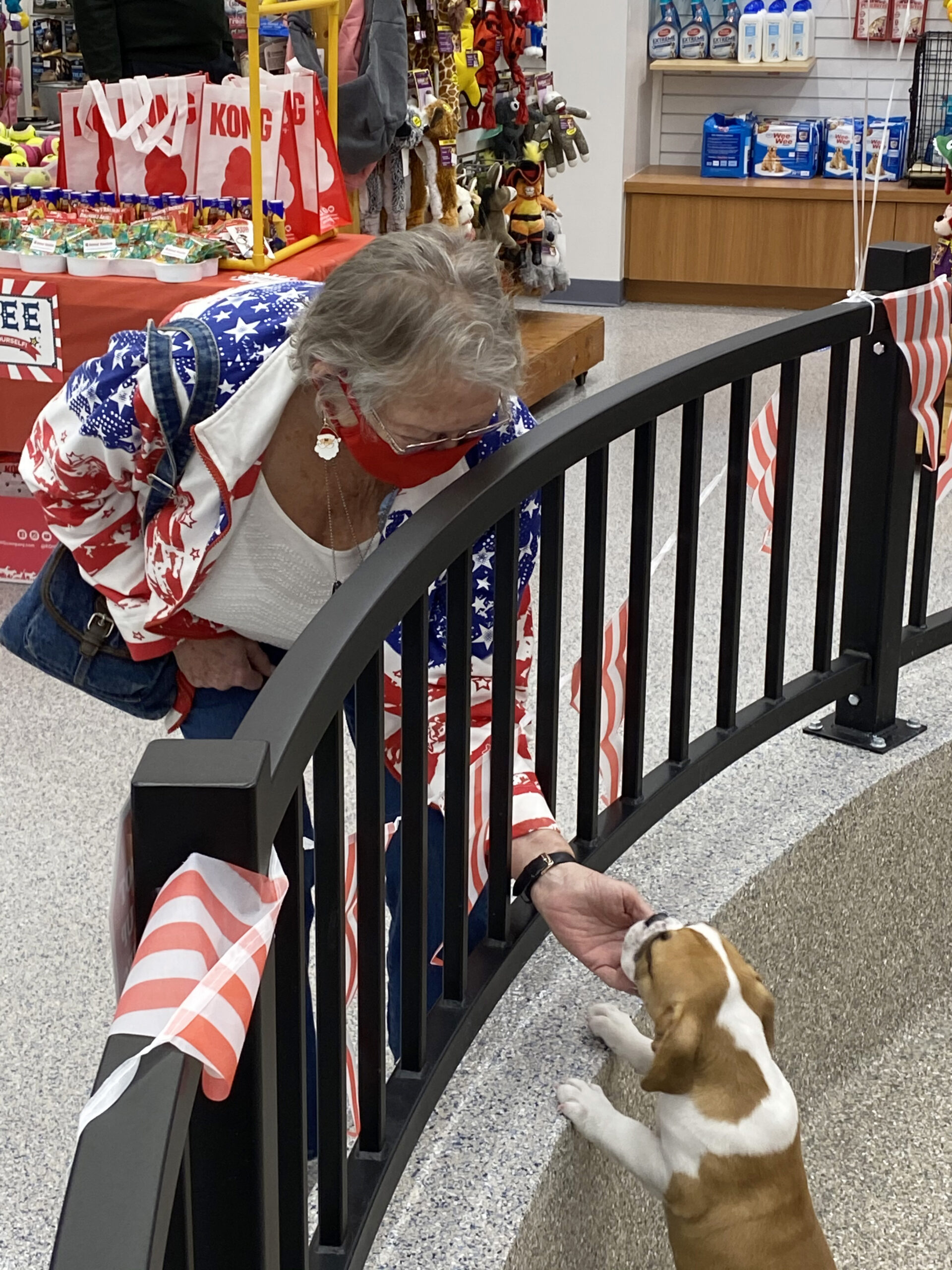Sheron Jones greets a puppy at the store
